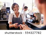 cashier accepts card payment... | Shutterstock . vector #554327782
