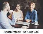 two women and a man at cafe ... | Shutterstock . vector #554335936