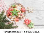 gingerbread cookies on white... | Shutterstock . vector #554339566