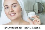 young woman with a towel on his ... | Shutterstock . vector #554342056