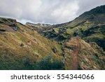 girl hiking iceland on the...   Shutterstock . vector #554344066
