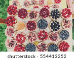 fruit and berry tartlets... | Shutterstock . vector #554413252