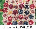 fruit and berry tartlets... | Shutterstock . vector #554413252