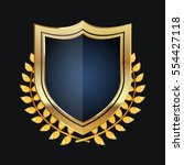 golden shield with laurel... | Shutterstock .eps vector #554427118