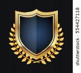 golden shield with laurel... | Shutterstock .eps vector #554427118