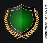 golden shield with laurel... | Shutterstock .eps vector #554427175