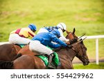 Stock photo race horses and jockeys competing for first place in a race 554429962