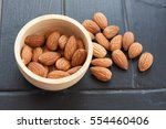 almond on a wooden table | Shutterstock . vector #554460406