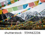 prayer flags with snow mountain   Shutterstock . vector #554462236