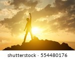 man on the peak of mountain and ... | Shutterstock . vector #554480176