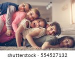 large group of children lying... | Shutterstock . vector #554527132