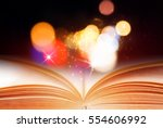 abstract magic book on wooden... | Shutterstock . vector #554606992