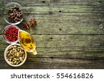 spices on wooden table ... | Shutterstock . vector #554616826