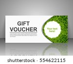 Gift voucher template with green leaves