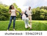 family  parenthood  adoption... | Shutterstock . vector #554623915