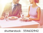 Small photo of restaurant, food, people, date and holiday concept - close up of happy couple talking at restaurant