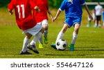 children playing soccer sport... | Shutterstock . vector #554647126