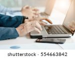 male hands typing on laptop... | Shutterstock . vector #554663842