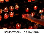 hand of child  lights a red... | Shutterstock . vector #554696002