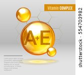 vitamin a e gold shining pill... | Shutterstock .eps vector #554703982