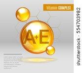 vitamin a e gold shining pill... | Shutterstock .eps vector #554703982