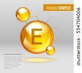 vitamin e gold shining pill... | Shutterstock .eps vector #554704006