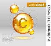 vitamin c gold shining pill... | Shutterstock .eps vector #554704375