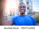 black guy in blue shirt and... | Shutterstock . vector #554711002