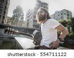 hipster guy wearing sunglasses... | Shutterstock . vector #554711122