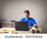 guy concentrated on studying  | Shutterstock . vector #554724616