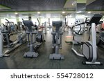 interior of a fitness hall with ... | Shutterstock . vector #554728012