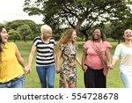 group of women socialize... | Shutterstock . vector #554728678