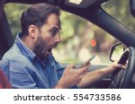 man sitting inside car with... | Shutterstock . vector #554733586
