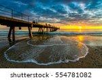 people walking along glenelg... | Shutterstock . vector #554781082