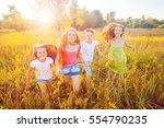 four happy beautiful children... | Shutterstock . vector #554790235