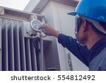 electrician working on checking ... | Shutterstock . vector #554812492