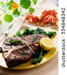 beef steaks with grilled... | Shutterstock . vector #554848342