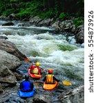 three whitewater kayakers...   Shutterstock . vector #554873926