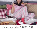 woman sitting on couch  eating... | Shutterstock . vector #554961352