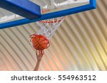 basketball going through the... | Shutterstock . vector #554963512