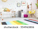 baby room with yellow chair and ... | Shutterstock . vector #554963806