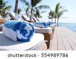 rolled up towels on sunbeds by... | Shutterstock . vector #554989786