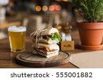tasty and appetizing sandwich... | Shutterstock . vector #555001882