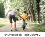 father learn his little son to... | Shutterstock . vector #555030952