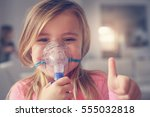 little girl using inhaler and... | Shutterstock . vector #555032818