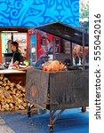 Small photo of Prague, Czech Republic - June 10, 2012: Shank cooking booth in Old town of Prague, Czech Republic. Chief on the background