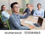 smiling businessman raising... | Shutterstock . vector #555084865