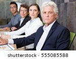 serious people sitting in row... | Shutterstock . vector #555085588
