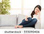 woman suffering headache... | Shutterstock . vector #555090406