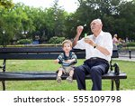 grandfather blowing soap... | Shutterstock . vector #555109798